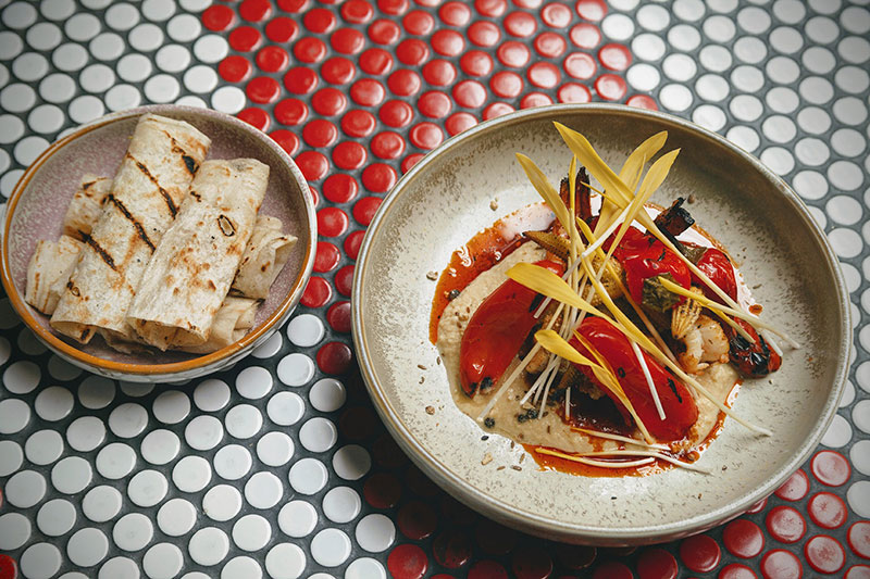 Char-grilled prawns with corn, pickled capsicum and flatbread