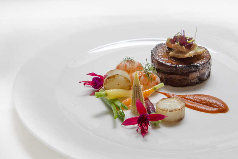 Free range braised pork belly, chorizo puree, yabbies and crackling with petite vegetables & flowers